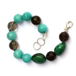 Silver bracelet with green stones and fumé quartz