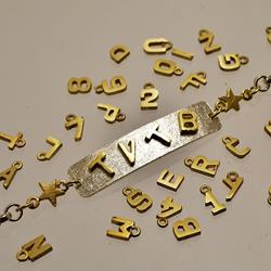 Silver and gold bracelet with nameplate and TVTB gold