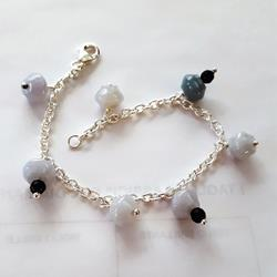 Silver bracelet and charms of jade and onyx